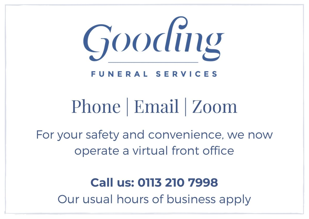 A notice which says you can contact Gooding Funeral Services by phone, email or by Zoom.  The photo also shows the hours of business