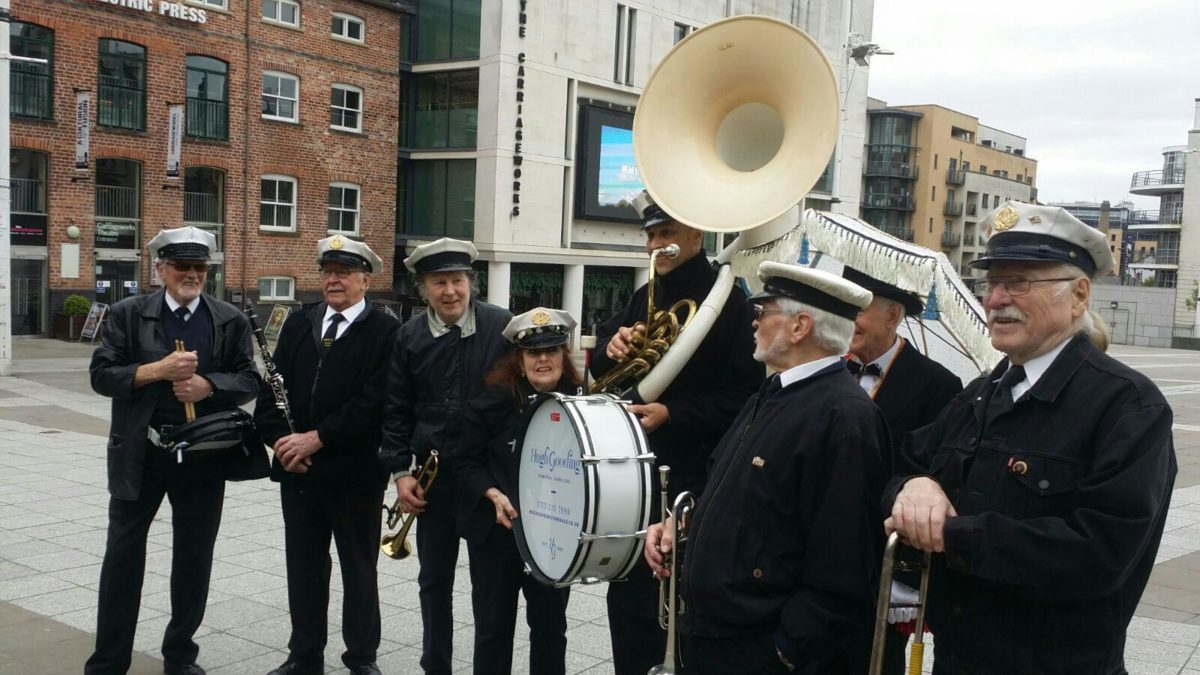 Gooding New Orleans Band standing together at Millennium Square with their instruments