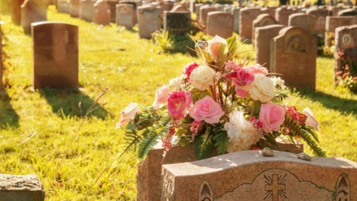 Getty Image used by BBC News. Image shows flowers on a grave within a cemetery