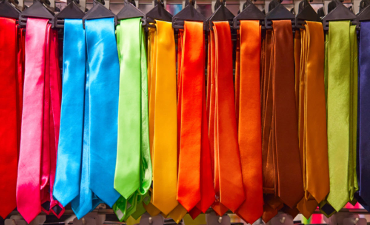 A selection of colourful hanging mens ties.